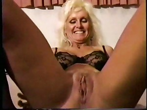 Darksome mate pounds and creampie a golden-haired older wench