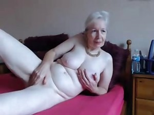 Amateur. Charming excited granny masturbates