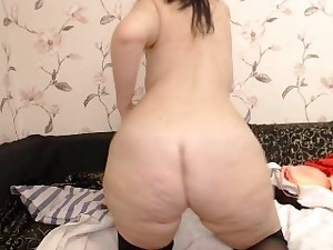 curvy great arse milf in goggles disrobes on web camera