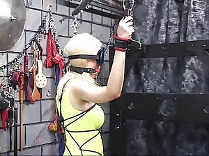 Submisive blond young lady serf receive boundage and torment on foreign hold
