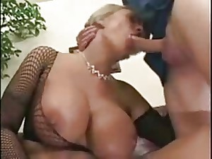 Golden-haired Milf With Giant Breasts in Fishnets SM65