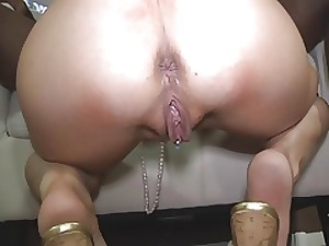 Glamorous blond wife copulates a BBC on a tub table