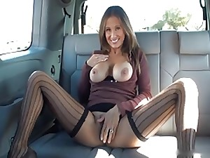 Wife Gives Tugjob in Backseat