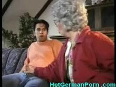 German gammer catches her young boy masturbating and copulates him