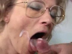 German granny receives fist fuck and facial