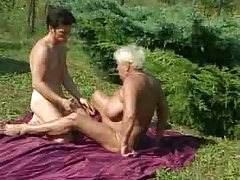 Granny bonks outdoors