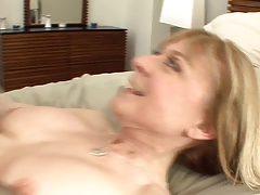 Breasty cougar seduces in nylons and a garter