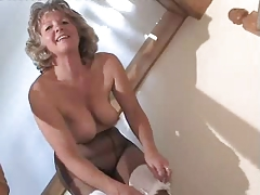Bewitching Granny In Dark Hose Toying On The Steps
